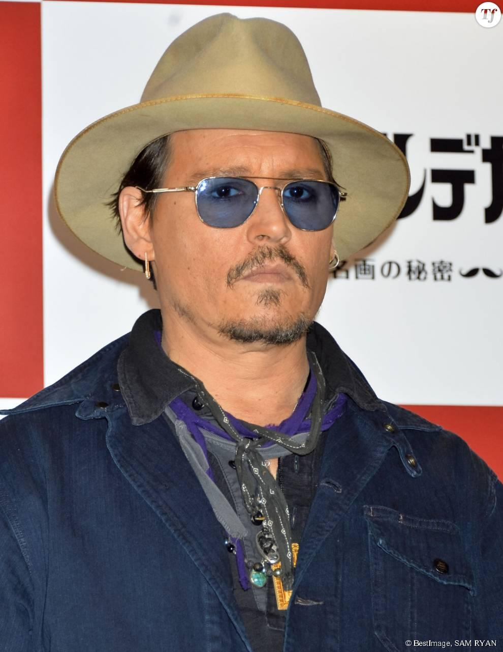 "Johnny Depp lors du photocall du film ""Charlie Mortdecai"" à Tokyo, le 28 janvier 2015."
