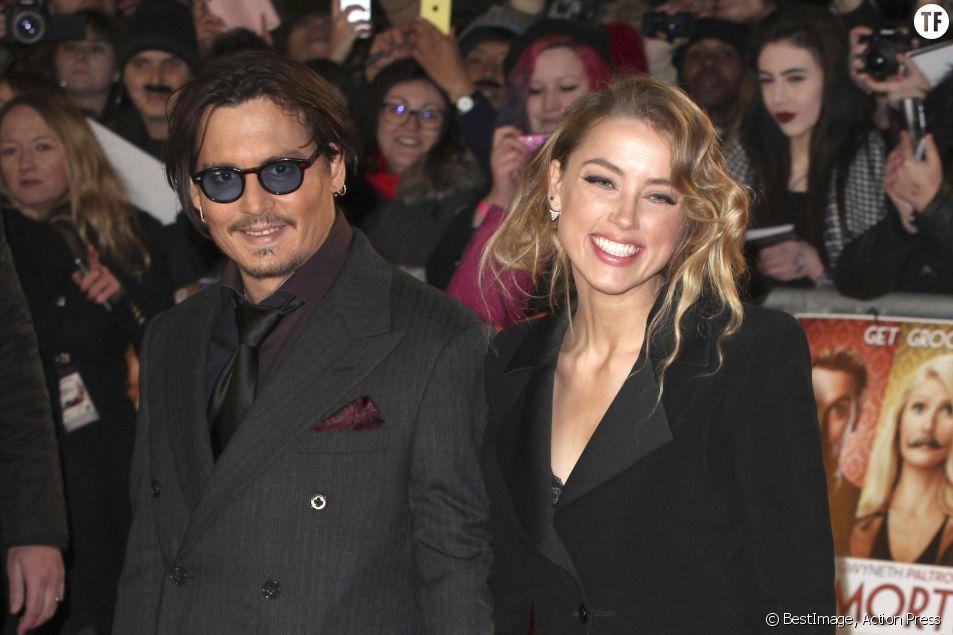 """Johnny Depp et sa femme Amber Heard à la première du film """"Charlie Mortdecai"""" en janvier 2015"""