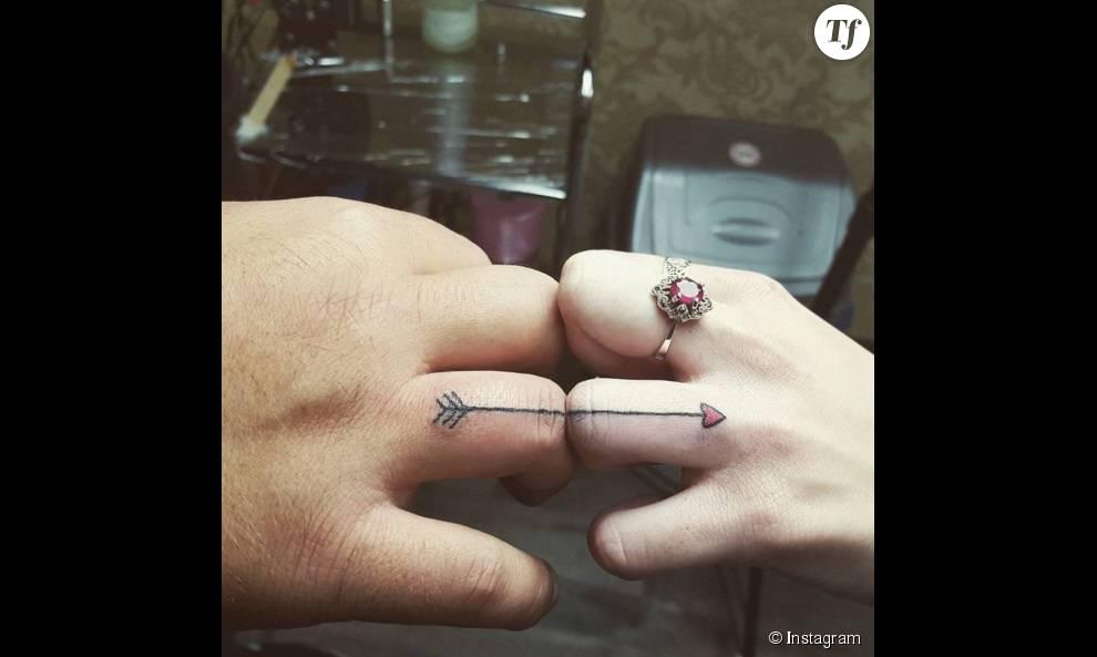 https//static1.terrafemina.com/articles/0/29/64/70/@/359345,tatouage,alliance,fleche,990x0,2