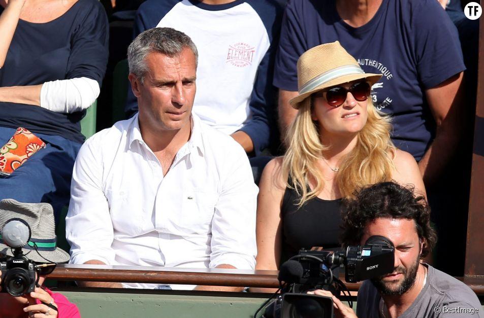 Yann Delaigue et sa compagne Astrid Bard - People dans les tribunes des Internationaux de France de tennis de Roland Garros le 3 juin 2015.