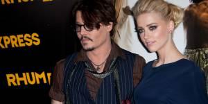 Johnny Depp et Amber Heard en couple au concert des Rolling Stones