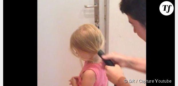 Il attache les cheveux de sa fille avec un aspirateur - vidéo