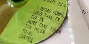 TVA sociale et taxe Tobin votées au Parlement sous le feu des critiques