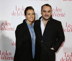 Francois-Xavier Demaison et sa femme Emmanuelle - Avant-premiere 'Le Jeu de la verite' au Gaumont Opera Capucines a Paris le 20 janvier 2014.