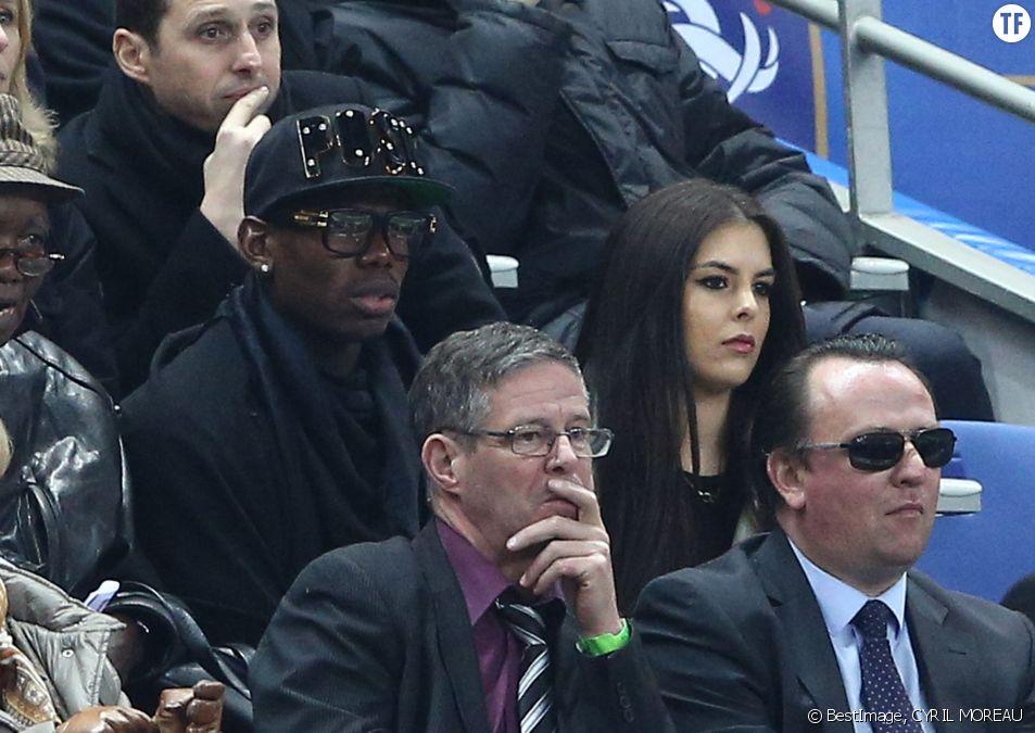 Paul Pogba et sa compagne au match amical France - Brésil au Stade de France à Saint-Denis le 26 mars 2015