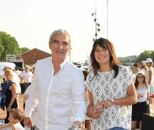 Raymond Domenech et sa compagne Estelle Denis le 2 juillet dernier
