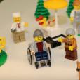 Il existe aussi une figurine en fauteuil roulant