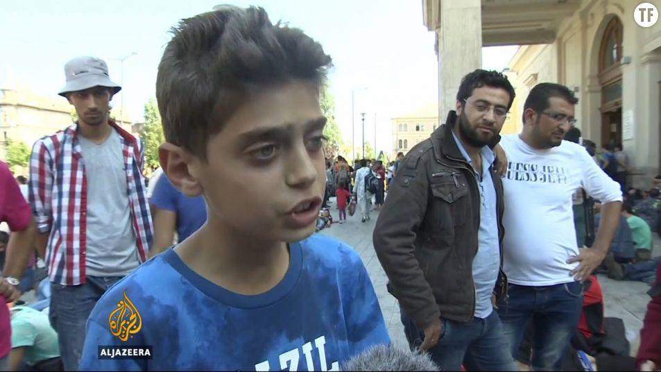 Le jeune migrant syrien Kinan Masalmeh appelle à la fin de la guerre