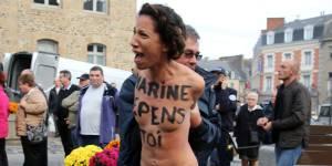 Marine Le Pen bousculée par deux Femen - vidéo