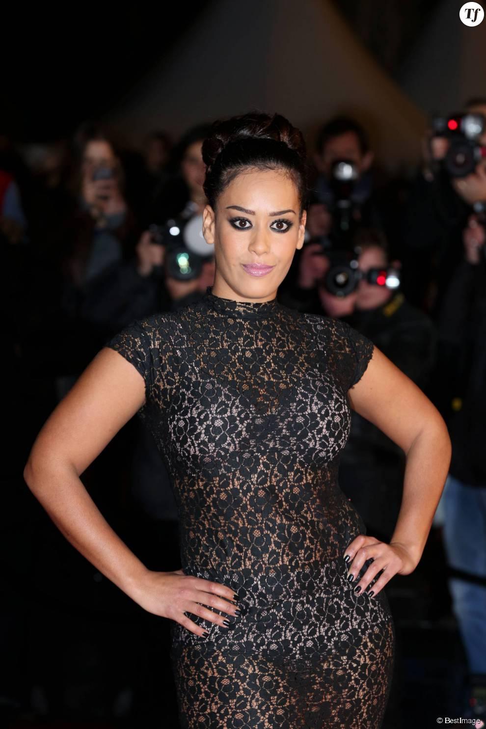 Amel Bent en robe en dentelle transparente à la 15e édition des NRJ Music Awards à Cannes le 14 decembre 2013