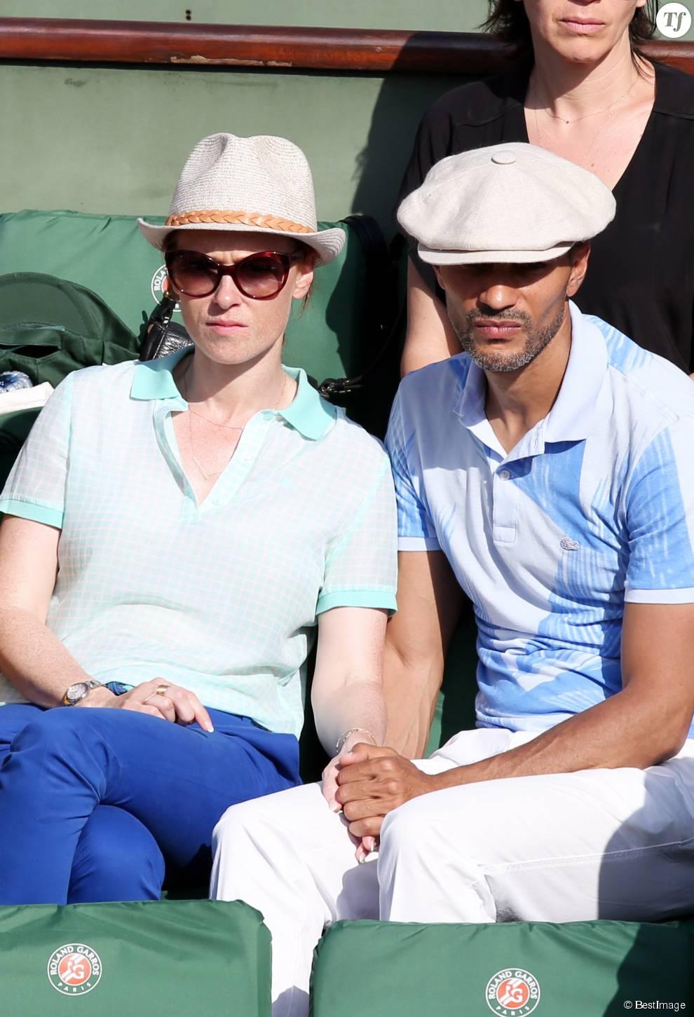 Audrey Fleurot et son nouveau compagnon Djibril Glissant assistent à la finale dame lors des Internationaux de France de tennis de Roland Garros à Paris le 7 juin 2014.
