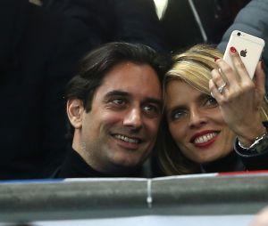 Sylvie Tellier et son compagnon Laurent au match de football France - Russie au Stade de France à Saint-Denis le 29 mars 2016.