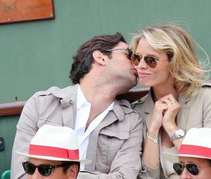 Sylvie Tellier et son compagnon Laurent aux Internationaux de France de tennis a Roland Garros a Paris le 2 juin 2013.