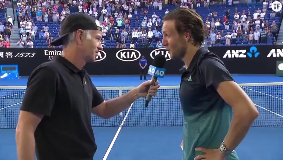 Lucas Pouille au micro de Jonh McEnroe à l'Open d'Australie après son quart de finale