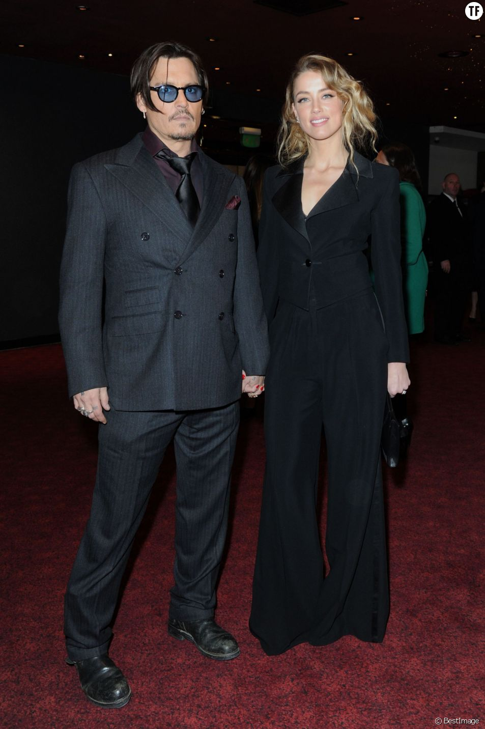 """Johnny Depp et sa fiancée Amber Heard - Avant-première du film """"Charlie Mortdecai"""" à Londres, le 19 janvier 2015."""