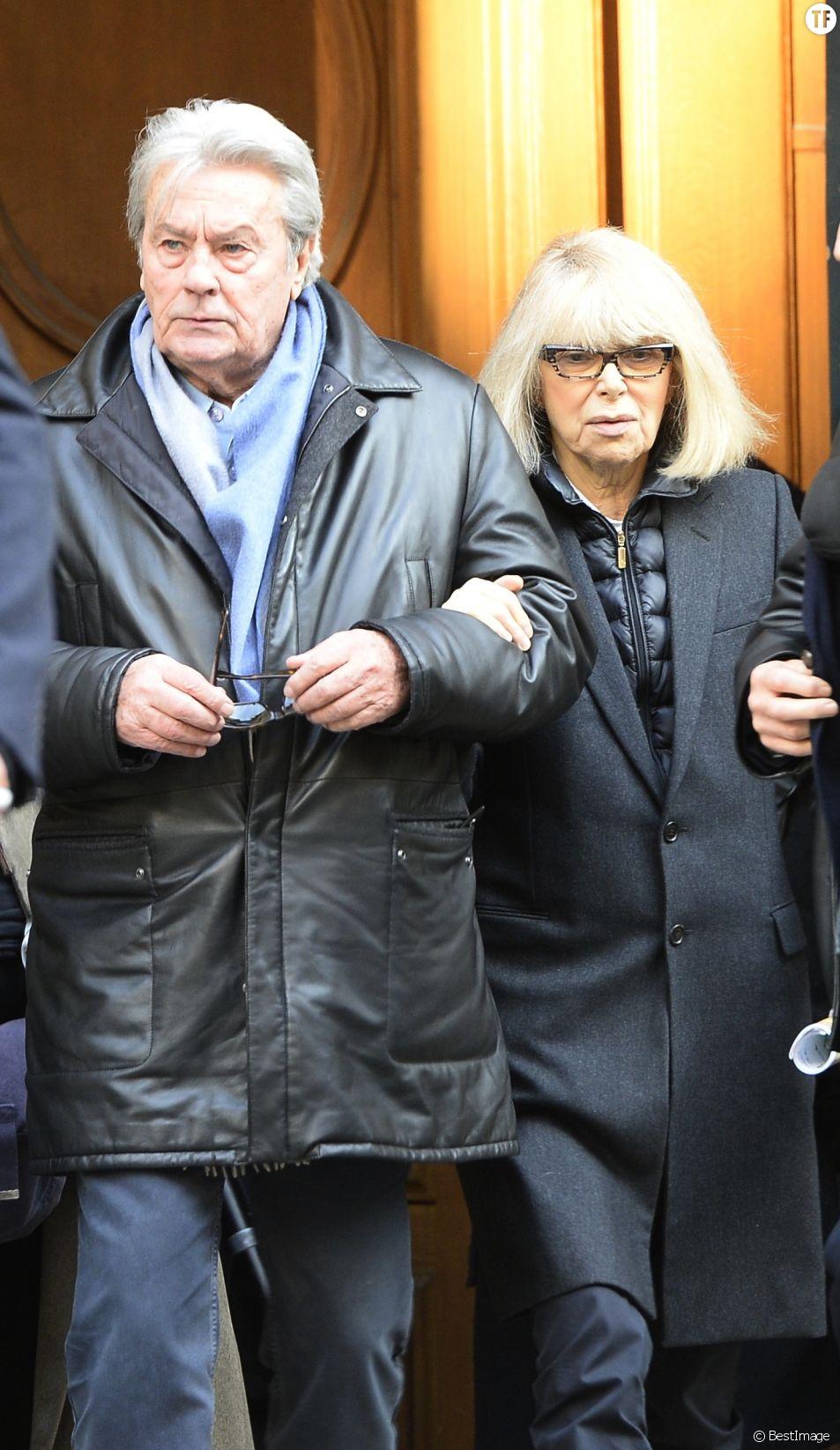 Alain Delon et Mireille Darc - Hommage a Georges Lautner en l'eglise Saint-Roch a Paris. Le 5 decembre 2013